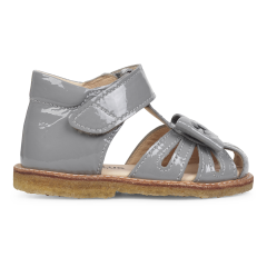 Starter sandal with a bow and velcro closure